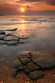 Seascape of Mollusk Fossil Site at sunrise,Krabi,Thailand — Stock Photo
