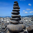 Stack of stones on the Hin nam beach, Lipe, Thailand - Stock Photo