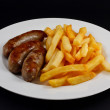 Plate of Sausage and chips. — Stock Photo #10013339
