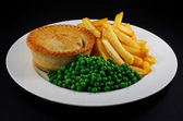 Pie and chips with peas. — Stock Photo
