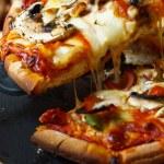 Funghi Pizza slice — Stock Photo #10530158