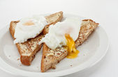 Poached eggs on toast — Stock Photo