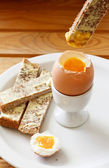 Boiled egg and buttered toast — Stock Photo