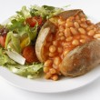 Baked Bean Jacket Potato with side salad - Stock Photo