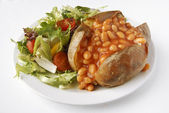 Baked Bean Jacket Potato with side salad — Stock Photo