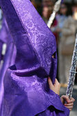 Semana Santa, Nazarene with white purple robe in a procession — Stock Photo