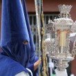 Semana Santa, Nazarene with blue robe in a procession - Stock Photo