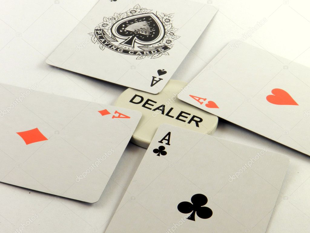 A poker hand of aces and the dealer  Stock Photo #10117054