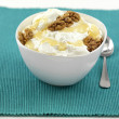 A bowl of yogurt with honey and walnuts — Stock Photo #10105223