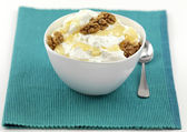 A bowl of yogurt with honey and walnuts — Stock Photo