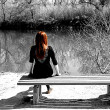 Redhead on bench — Stock Photo