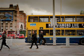 Dublin street with bus and — Stock Photo