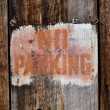 No Parking Sign against aged wood — Stockfoto