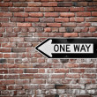 Stock Photo: Brick Wall with One Way Sign