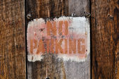 No Parking Sign against aged wood — Stock Photo