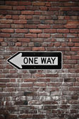 Brick Wall with One Way Sign — Stock Photo