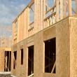 New Home Under Construction with Blue Sky and White Clouds — Stock Photo