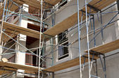 Scaffolding on a new apartment complex — Stock Photo