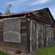 Stock Photo: Old Wooden Cabin against Blue Sky