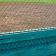 Royalty-Free Stock Photo: Baseball Diamond View through Chain Link Fence