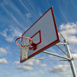 Basketball Hoop with Clouds - Stock Photo