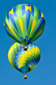 Two Green and Blue Hot Air Balloons — Stock Photo