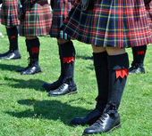 Plaid Scottish Kilts, Socks and Shoes — Stock Photo