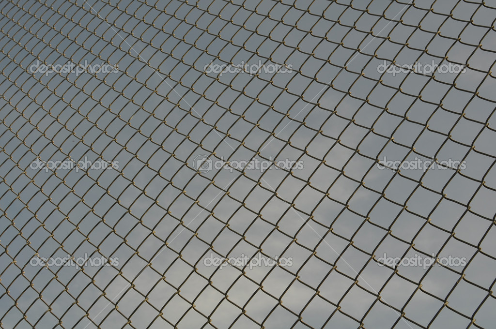 Chain Link Fence and blue sky Background  Stock Photo #9941190