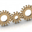Connection of the three gold gears — Stock Photo