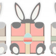 Easter bunnies with gifts. — Stock Vector