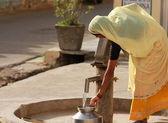 Woman Pumping Water — Stock Photo
