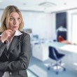 Attractive businesswoman is thinking in the office — Stock Photo #10071572