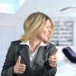 Happy business woman dancing in the office — Stock Photo #10071602