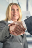 Businesswomen handshake to seal a deal — Stock Photo