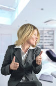 Happy business woman dancing in the office — Stock Photo