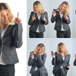 Attractive caucasian businesswoman listening to music — Stock Photo #10111138