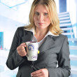 Attractive caucasian business woman with a cup of tea — Stock Photo #10111166