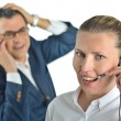 Beautiful business woman with headset and talking to a businessm — Stock Photo