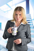 Attractive caucasian business woman with a cup of tea — Stock Photo