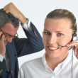 Stock Photo: Beautiful business woman with headset and talking to a businessm
