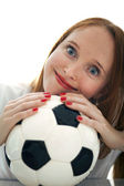 Attractive blond girl holding a soccer ball isolated — Stock Photo