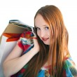Young beautiful female holding paper-bags with purchases — Stock Photo #10468516