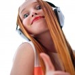 Red headed woman with headphones listening to music — Stock Photo #10677312