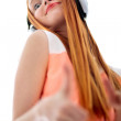 Long haired beautiful girl with headphone listening to music — Stock Photo