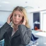 Portrait of young businesswoman having headache pains — Stock Photo