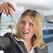 Young and beautiful business woman holding keys — Stock Photo