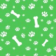 Background with dog paw print and bone — Stock Vector #10595605