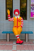 Ronald McDonald sitting on the chair — Stock Photo