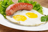 Fried eggs with sausage — Stock Photo