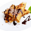 French crepes with chocolate syrup - Stock Photo